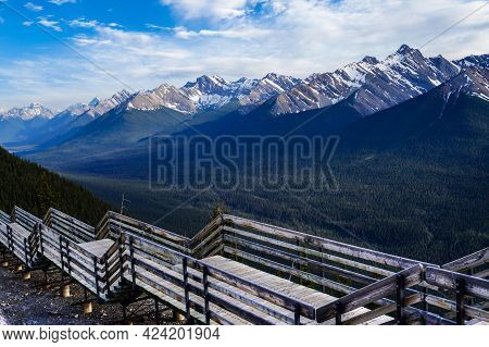A Wooden Walkway On Top Of Sulphur Mountain With Panoramic View Of The Canadian Rockies In Banff Nat