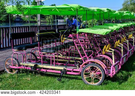 Mogosoaia, Romania - 7 May 2021: Many Colorful Double Surrey Tandem Bicycles Available For Rent At T