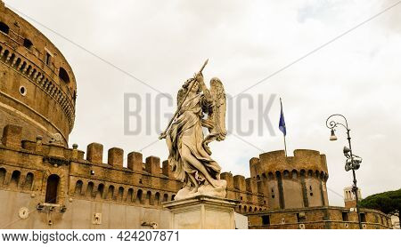 Rome, Ponte Sant'angelo. This Statue Is Named Angel With The Lance, And Its Located At One Of The En