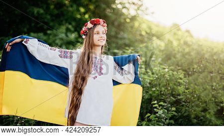Ukraines Independence Anniversary Day. Constitution Day. Ukrainian Child Girl In Embroidered Shirt V