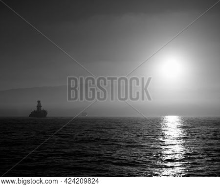 Sunset From The Bay With Backlit Ships And Silhouette Of The Gran Canaria Island, Spain
