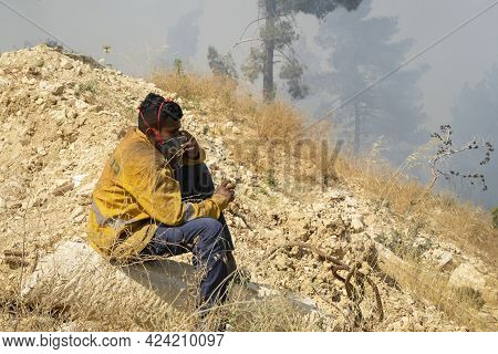 Mevasseret Zion, Israel - June 19th, 2021: A Young Fire Fighter Taking A Break While Fighting A Fore