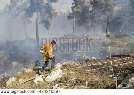 Mevasseret Zion, Israel - June 19th, 2021: A Young Fire Fighter During A Pine Forest Fire On The Mun