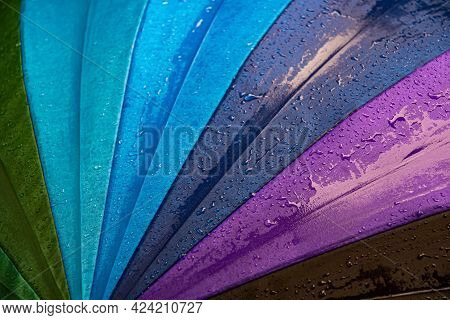 Wet Waterproof Textile Surface Of Blue Gradient Colored Umbrella Under Drizzle Rain. Water Drops Dri