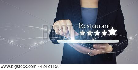 Increase Rating Or Ranking, Evaluation And Classification Idea. White Tablet In Hand With Digital Ho