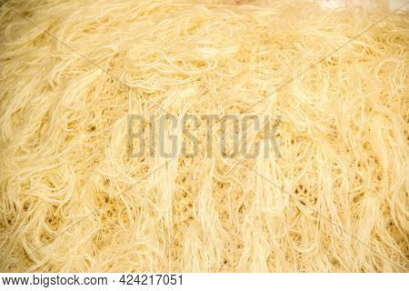 Close Up Of A Bundle Of Natural Or Man Made Beige Textile Fiber Strand Or Filament Fabric Yarn For W