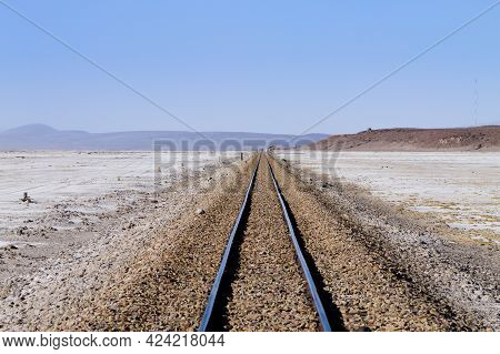 Train Tracks Perspective View From Bolivia. Bolivian Landscape. Salar De Colchani