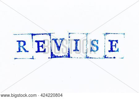 Blue Color Ink Rubber Stamp In Word Revise On White Paper Background