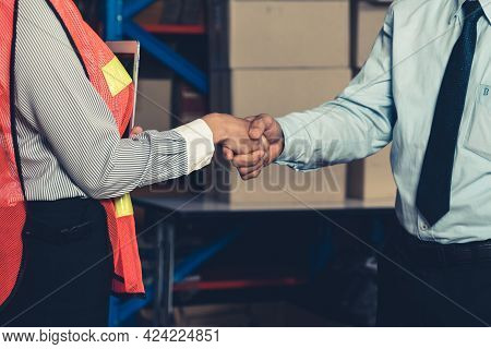 Warehouse Worker Handshake With Manager In Storehouse . Logistics , Supply Chain And Warehouse Busin