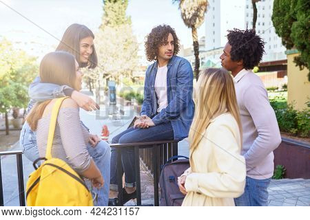 Multi-ethnic Group Of Students Talking In The Street
