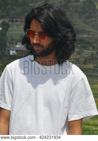 Portrait Of A Handsome Long Haired Indian Young Men Wearing Sunglasses With Looking Down, A Good Loo