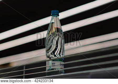 Few Drinking Mineral Water Bottles On Shelf Left In Department Store, Lack Of Goods