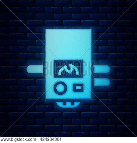 Glowing Neon Gas Boiler With A Burning Fire Icon Isolated On Brick Wall Background. Vector