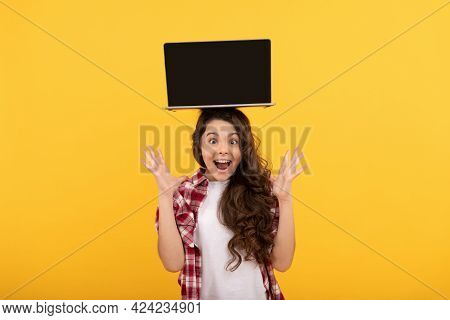 Amazed Smart Kid With Laptop On Head Presenting School Online Lesson, Elearning