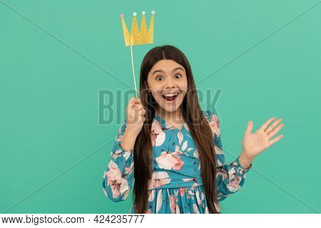 Happy Surprise For Princess. Surprised Princess Blue Background. Funny Girl Hold Prop Crown