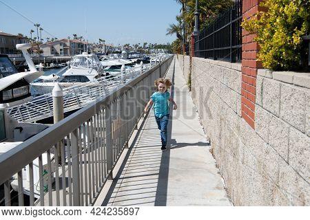 Summer Activity. Active Boy Run On Promenade. Activity Holidays. Energetic Child Enjoy Summertime