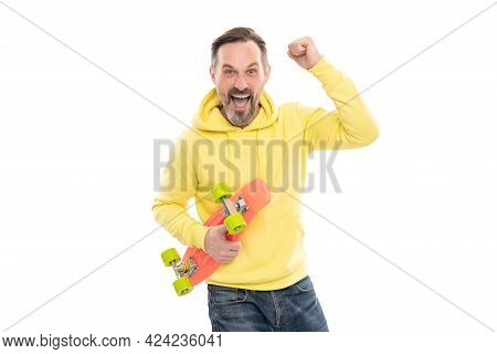Skateboarding. Mature Happy Man With Penny Board. Smiling Senior Guy Hold Pennyboard