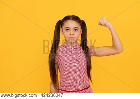 Serious Girl Child Show Power Gesture Flexing Arm Yellow Background, Strong