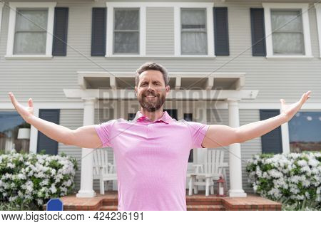 Happy Bearded Man Owner Near New House After Rent Or Buy New Home, Ownership