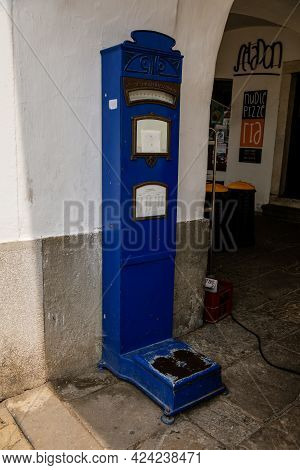 Blue Retro Vintage Weighing Floor Scale Standing On The Street, Measuring Weight, Renaissance Baroqu