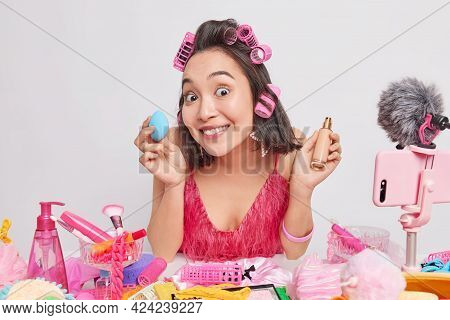 Positive Lady With Dark Hair Holds Sponge And Bottle Of Good Quality Foundation Records Record Broad