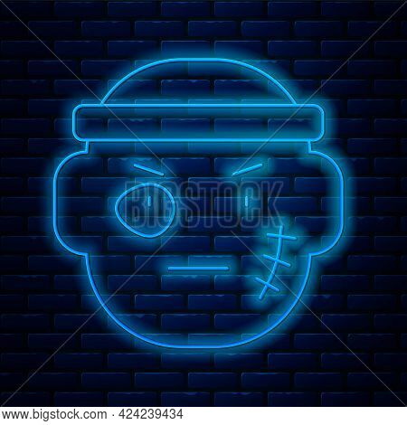 Glowing Neon Line Bandit Icon Isolated On Brick Wall Background. Vector