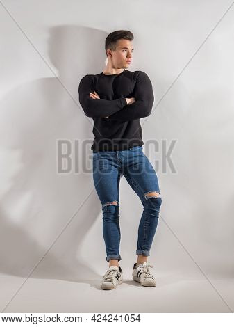One Handsome Young Man In Studio Shot, Standing Confindent With Arms Crossed