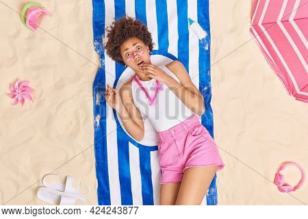 Frightened Emotional Ethnic Woman Shocked To Get Skin Burn After Sunbathing Poses With Red Face On B