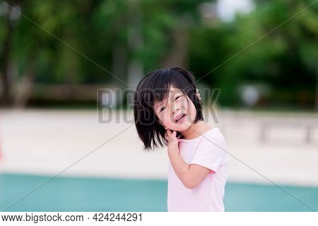 Asian Child Is Scratching His Neck Due To Itching. Hot Weather In The Summer Time. Cute Girl Is Swea