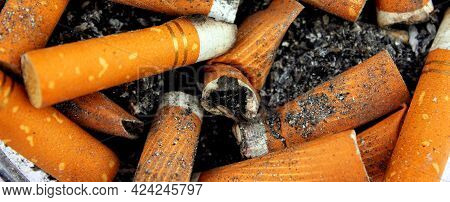 Close-up Of A Lot Of Dirty Used Butts Abstract Background. Health, Smoking, Health Hazards, Lekgy Ca