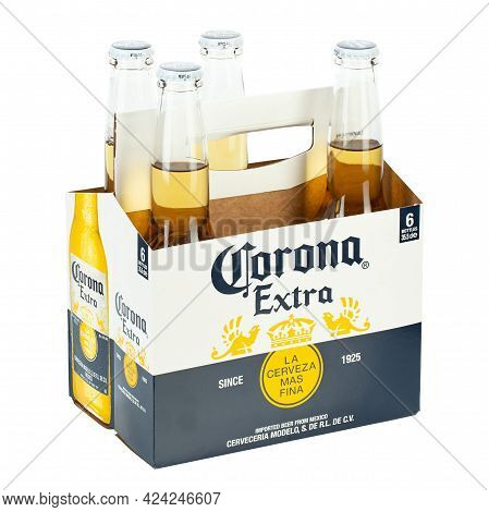 Ukraine, Kyiv - June 14. 2021: A 4 Bottle Of Corona Extra Beer Isolated On White Background, Side Vi