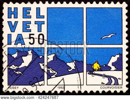 Moscow, Russia - June 16, 2021: Stamp Printed In Switzerland Shows Comic Strip By Cosey (bernard Cos
