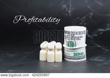 Peg Doll, A Roll Of Paper Money And The Word Profitability