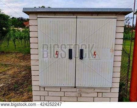 White Brick Box With Double-door For Electrical Distribution Grid Maintenance Entrance. Both Doors H