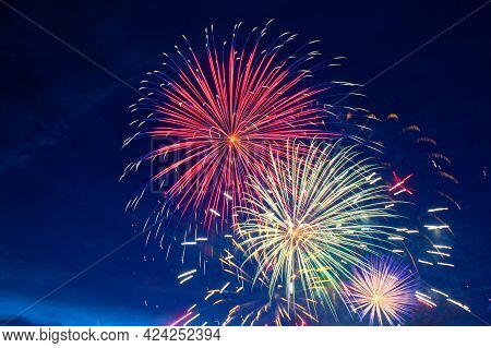 Fireworks On The Background Of The Cloudy Night Sky. 4th Of July - American Independence Day Usa