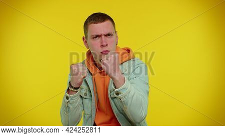 Aggressive Angry Sincere Teen Student Boy 20s Years Old In Denim Jacket Trying To Fight At Camera, S