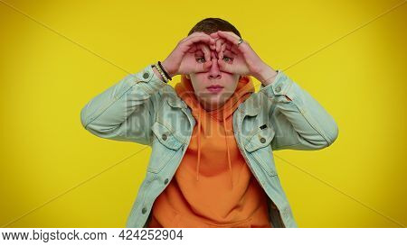 Nosy Curious Teen Stylish Boy Closing Eyes With Hand And Spying Through Fingers, Hiding And Peeping,