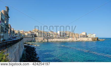 Ortigia Island, Syracuse, Sicily. View Of The Beautiful Seafront Of The Island, And Cala Rossa Beach