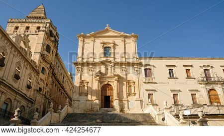 Noto, Sicily. Church Of Saint Francis Of Assisi To The Immaculate At Center. To The Left, The Buildi