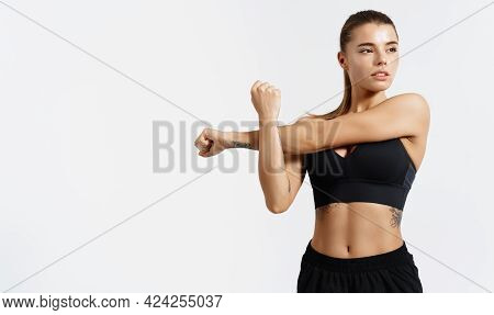 Determined, Strong And Healthy Sports Woman, Stretching, Stretch Her Arms, Warm Up For Workout In Gy