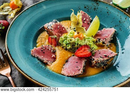 Fillet Of Tuna With Lentil And Avocado Puree In Plate On Wooden Background. Healthy Food, Seafood Cu