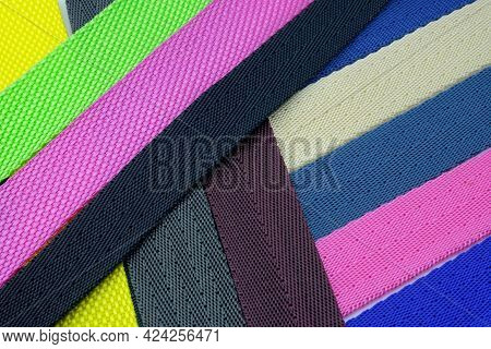 Colored Background From Belts Folded Diagonally. Colored Polyester Belts, Sample Palette For Making