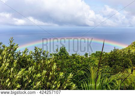 Colorful Rainbow Over Praslin Island With Tropical Rainforest Around, Azure Ocean Seen From Mont Azo