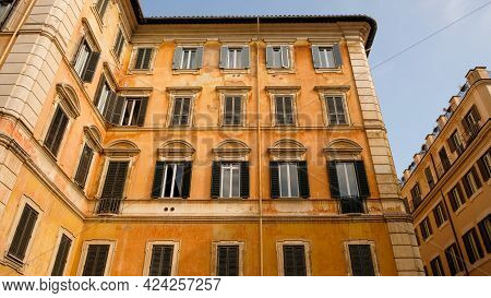 Rome, Trevi Neighborhood. A Building Of The Early Xix Century, With The Characteristic Ocher Facade.