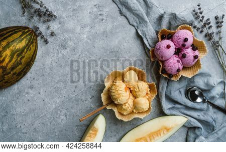 Berry And Melon Ice Cream Scoops On Waffle Basket On Light Grey Background With Flowers And Fresh Me