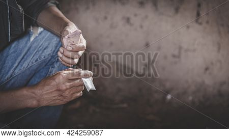 Drug Addict Buying Narcotics And Paying. International Day Against Drug Abuse And Illicit Traffickin
