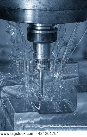 The Vertical Scene Of Cnc Milling Machine Cutting The  Mold Parts With Oil Coolant Method. The Mold