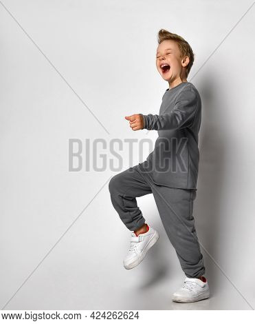Little Boy Child With European Outlook Studio Shot In Motion. A Twenty-year-old Blond Male Child In
