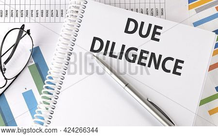Due Diligence , Pen And Glasses On The Chart, Business