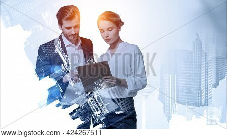 Businessman And Businesswoman In Office Clothes With Serious Look, Reading Paper Document. Business